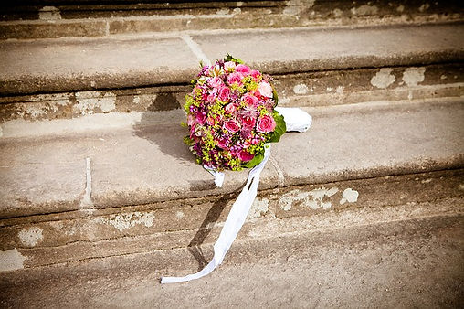 pink and green flowers on steps