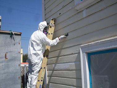 Crewmember scraping delaminating lead ba