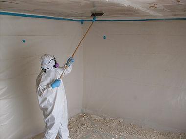 Crewmember scraping asbestos containing