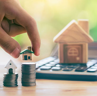 bigstock-House-On-Coins-And-House-Put-O-