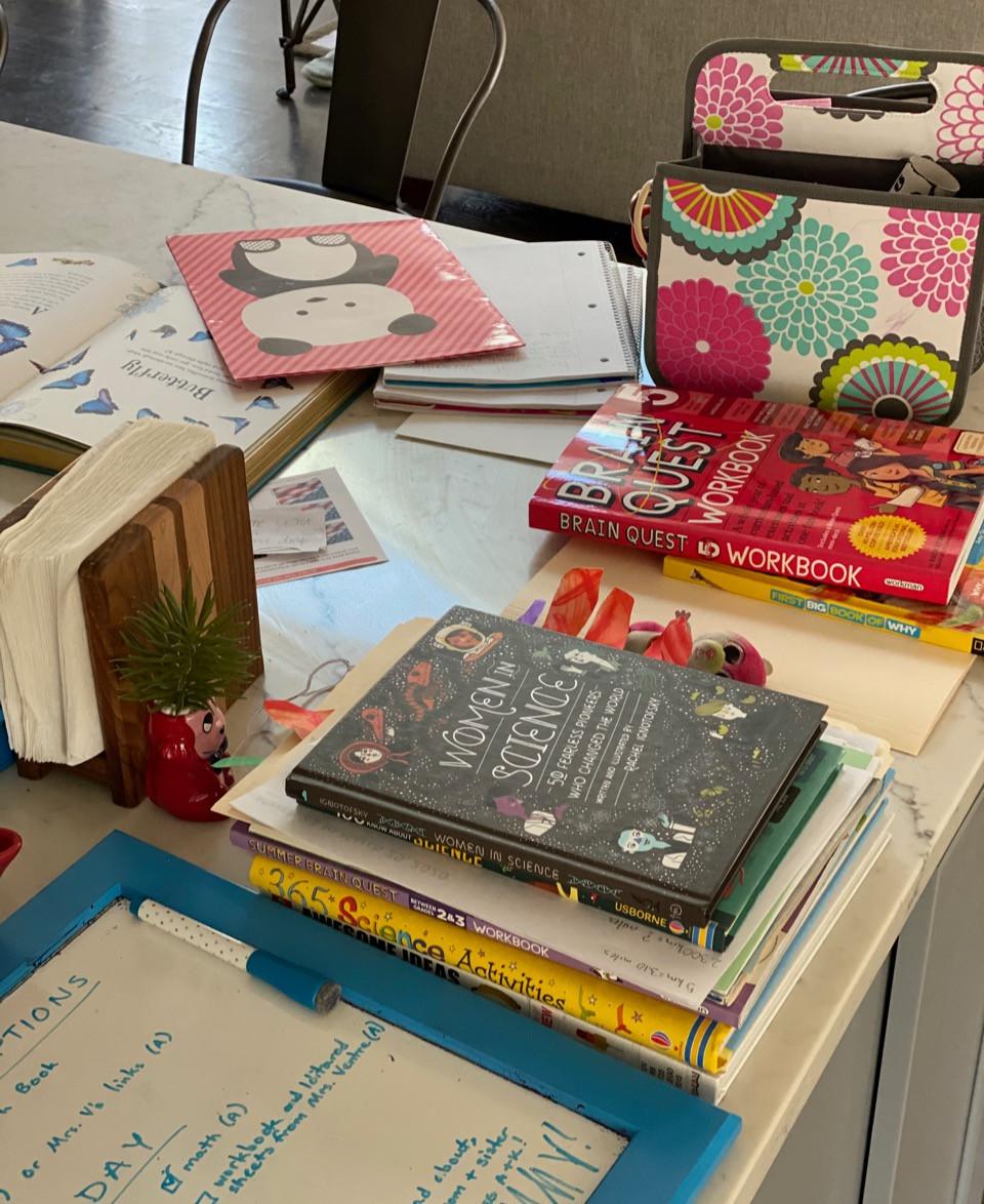 homeschool mess on counter; home school messy