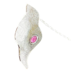 Reticulated silver pendant set with a pink cabochon stone available to buy on Etsy and soon to be la