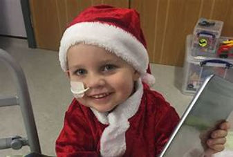 cancer kid at christmas.jpg