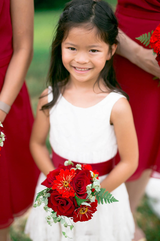 red flower girl bouquet