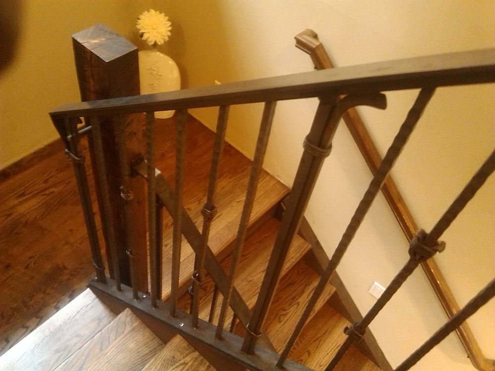 Hammered metal railing and barn wood stairs