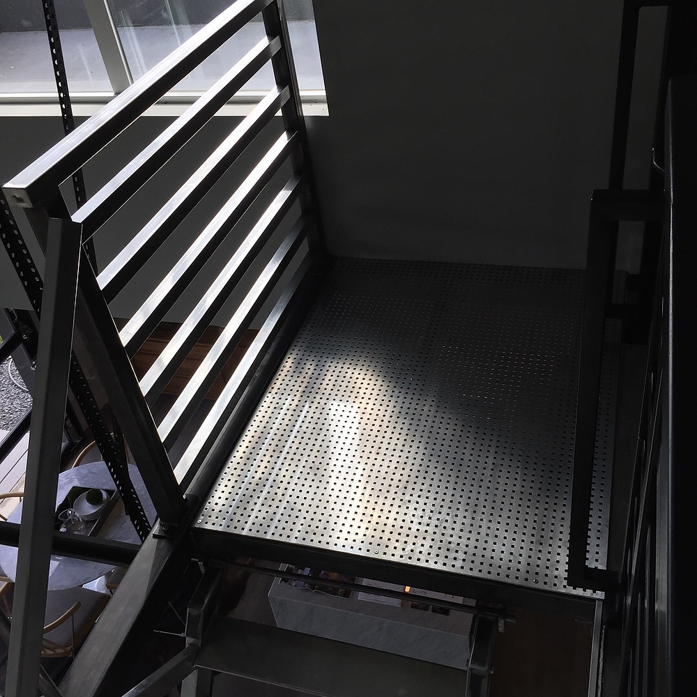 steel railing with aluminum perferated landing