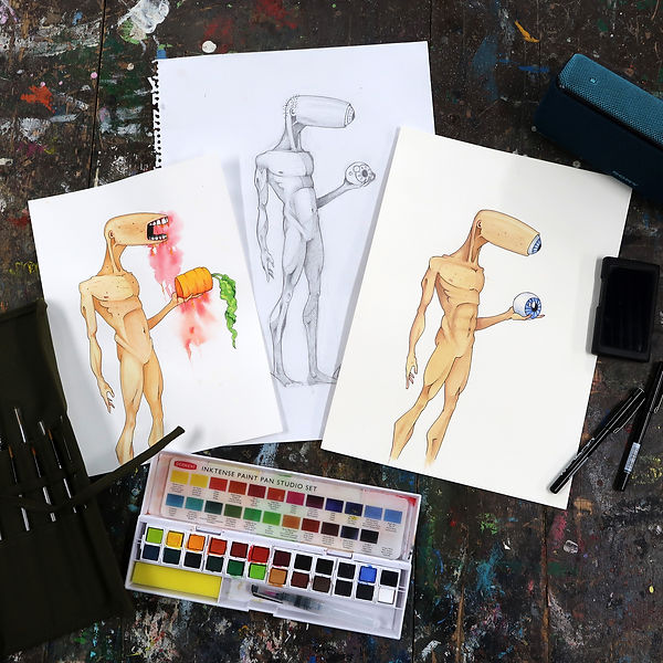 Three artworks in pencil, ink and watercolour of a humanoid figure. placed on a paint splattered table with a watercolour tray, pens and brushes.