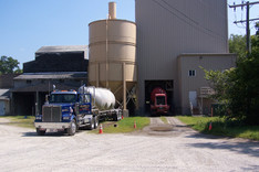 Plant with Material Tractor & Cement being loaded.jpg