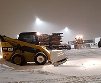 snow plowing with bobcat (2).jpg