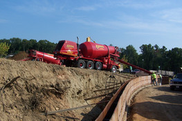 2 trucks pouring wall on gonthier's site again.jpg