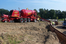 2 trucks pouring wall on gonthier's site.jpg