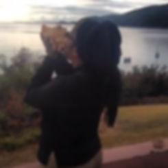 DaraMonifah blowing conch shell.jpg