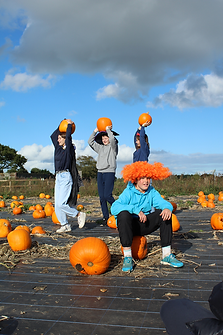 IMG_9486 pumpkins on heads.png
