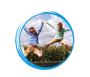 2 boys jumping pillow