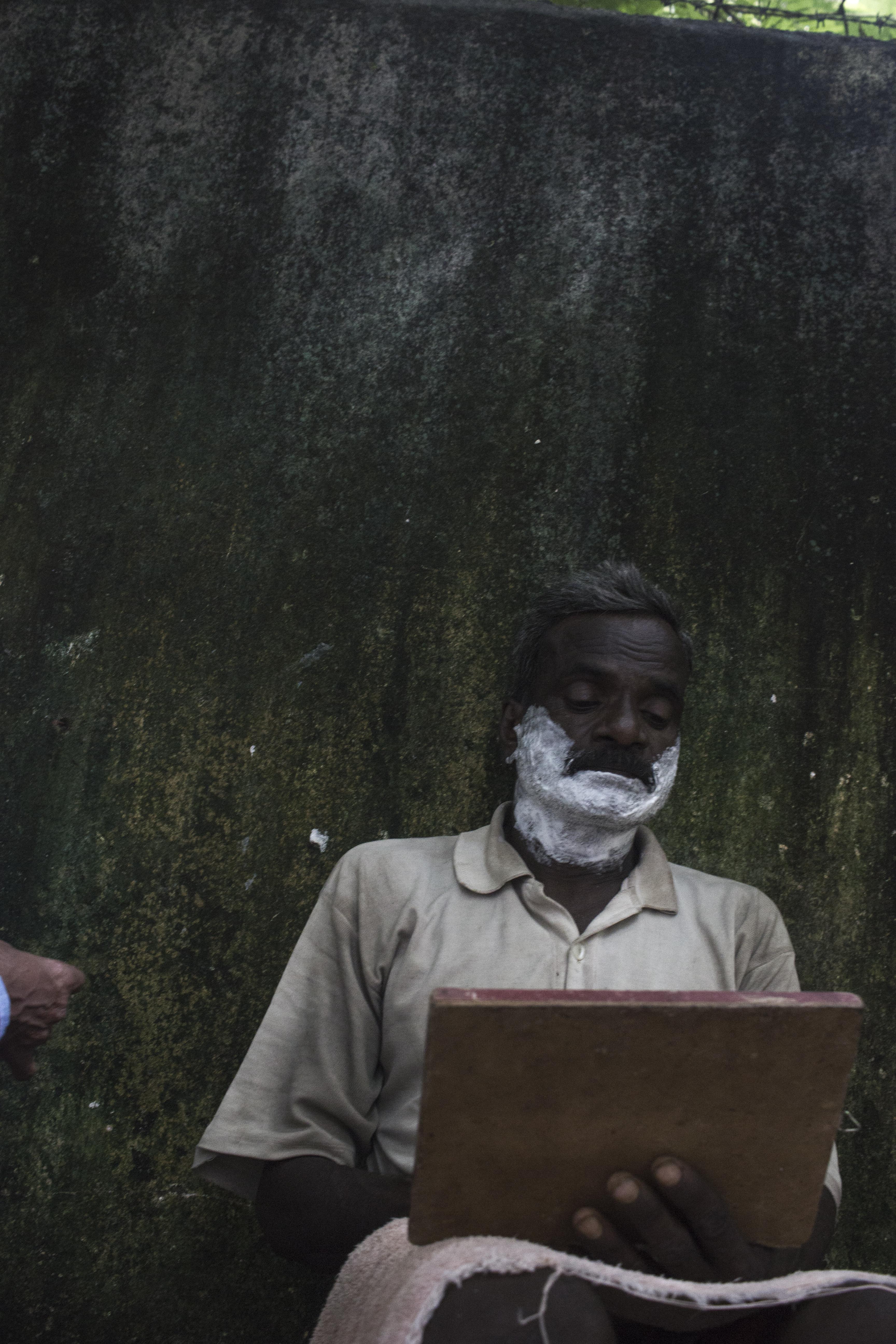 Mumbai, Man waiting for Shave, 2015