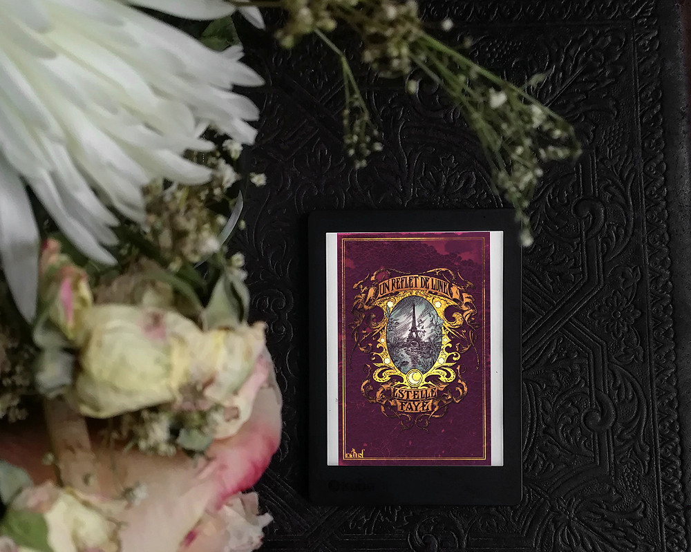 An ebook showing the cover of the novel on a dark background. White flowers hang over it, partly out of the frame and out of focus.