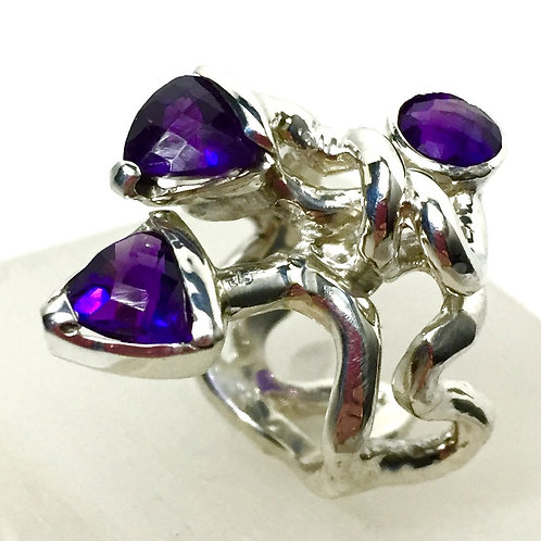 Sterling Silver ring with 2 trillion Amethysts and 1 round Amethyst, Intertwined