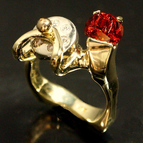 Gold Ring with Custom cut Garnet and Moving Disk of Diamonds
