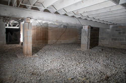 basement crawl space sans insulation.jpg
