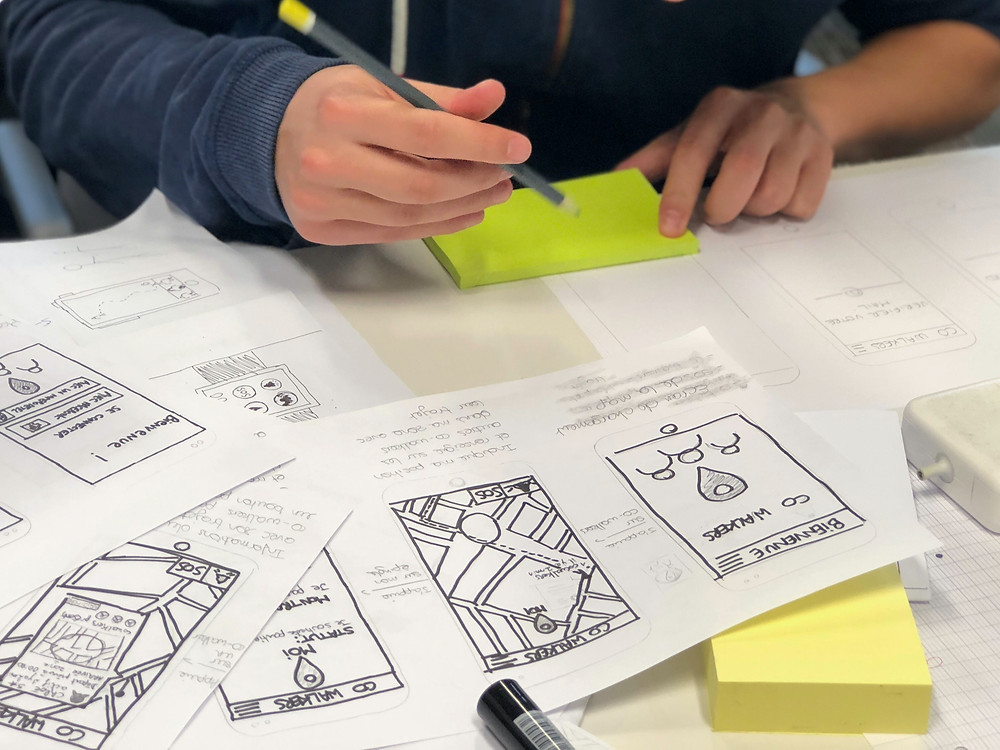 Person sketching wireframes