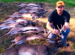 deer hunter with a buck