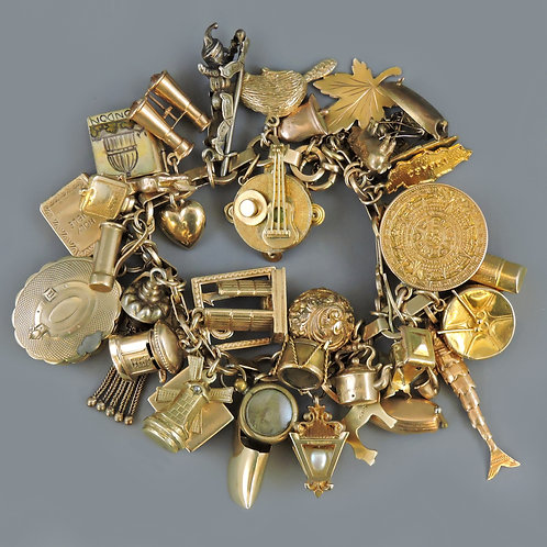 Stunning 9ct Gold Charm Bracelet with 45 Antique and vintage Charms 93.7g