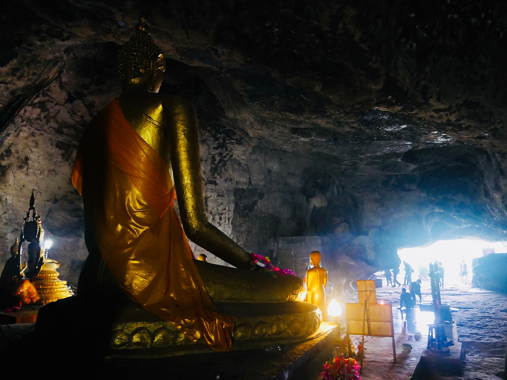 Krasae Cave Temple with Golden Buddha statue.