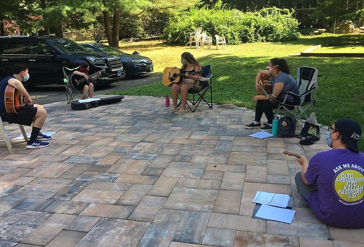 GIfting Guitar Teaching Outdoors