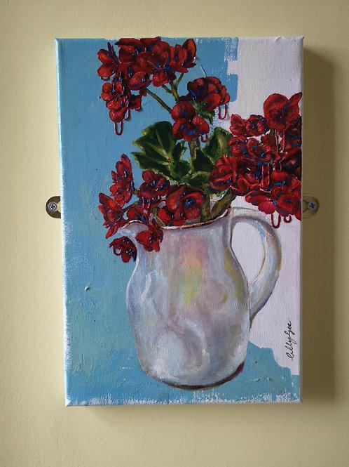 Red Flowers in a Milk Jug