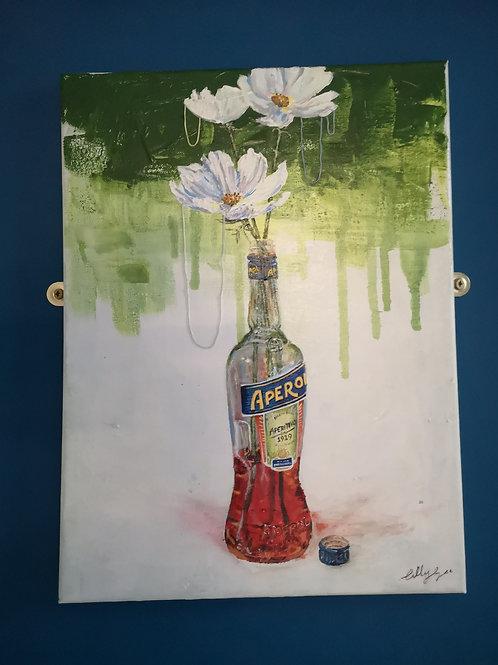 White Flowers in an Aperol Bottle