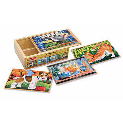 Set 4 rompecabezas de madera de animales en caja.