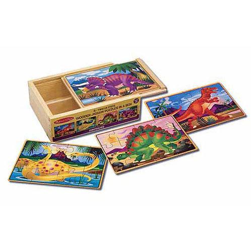 Set 4 rompecabezas de madera de Dinosaurios en caja.