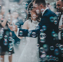 wedding%20couple%20dancing%20with%20bubbles_edited.jpg