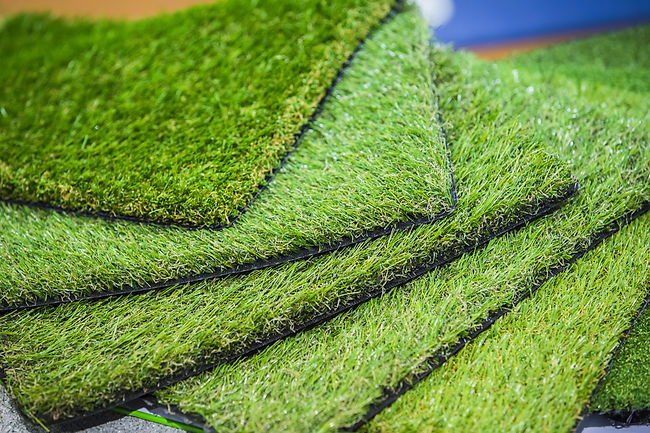 Green artificial turf rolled. Best Turf Companies