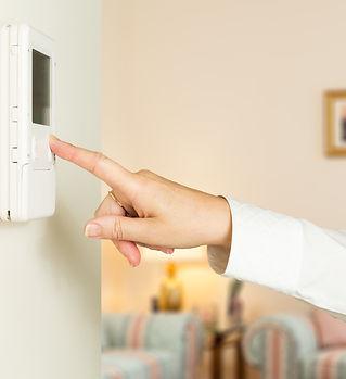 Caucasian female hand pressing button on