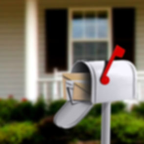 White Mail Box in Front of a House_edited.jpg