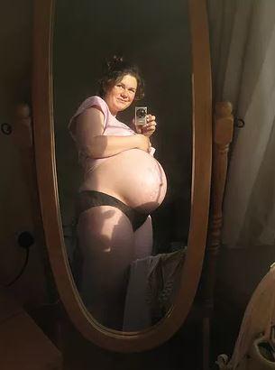 pregnant woman in mirror