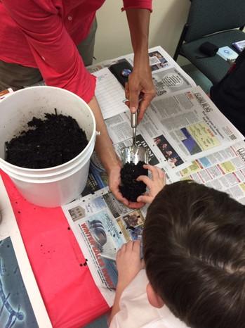 STEM nite boy touching compost.JPG