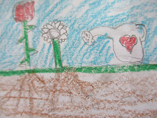 flowers roots and watering can.JPG
