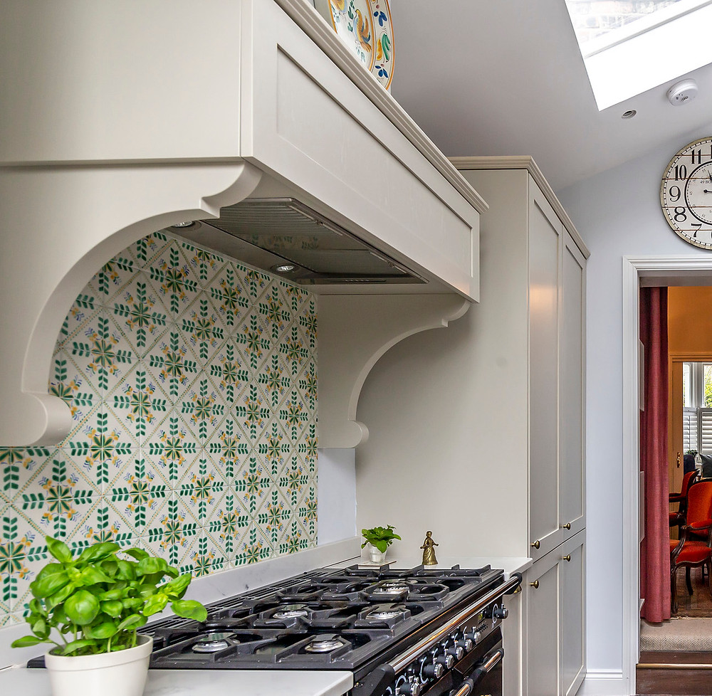French style canopy for extractor hood and green glazed tile splashback