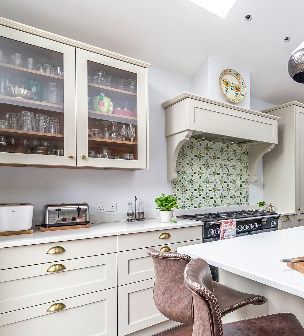 Kitchen island with pair of barstools under island overhang