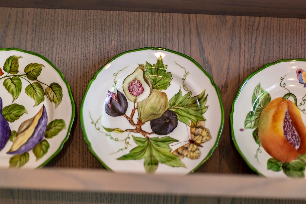 Detail of hand painted plates close up in mews kitchen refurb