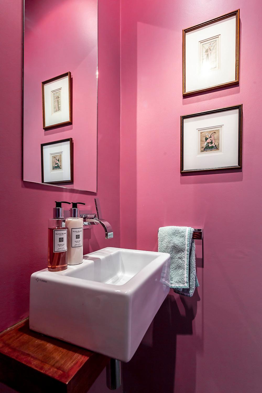 Downstairs cloakroom in Rangwali Pink walls in Kensington renovation