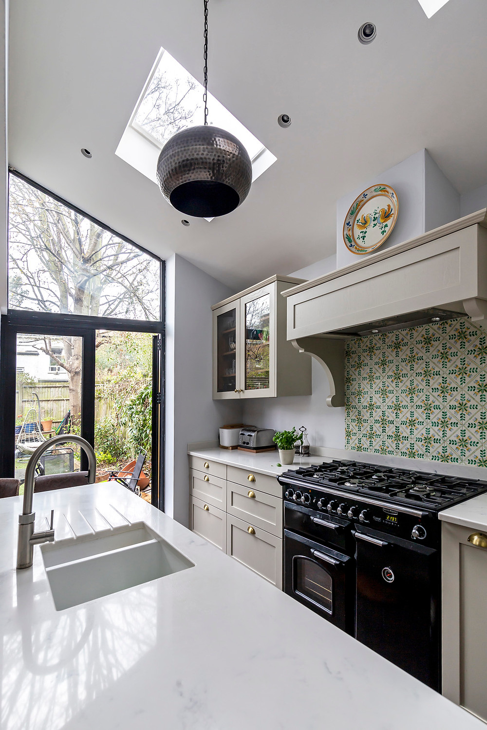 Kitchen island with Qooker tap opposite range cooker