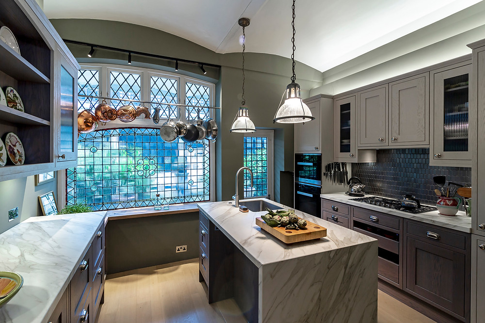 Kitchen view with central island and large paned window