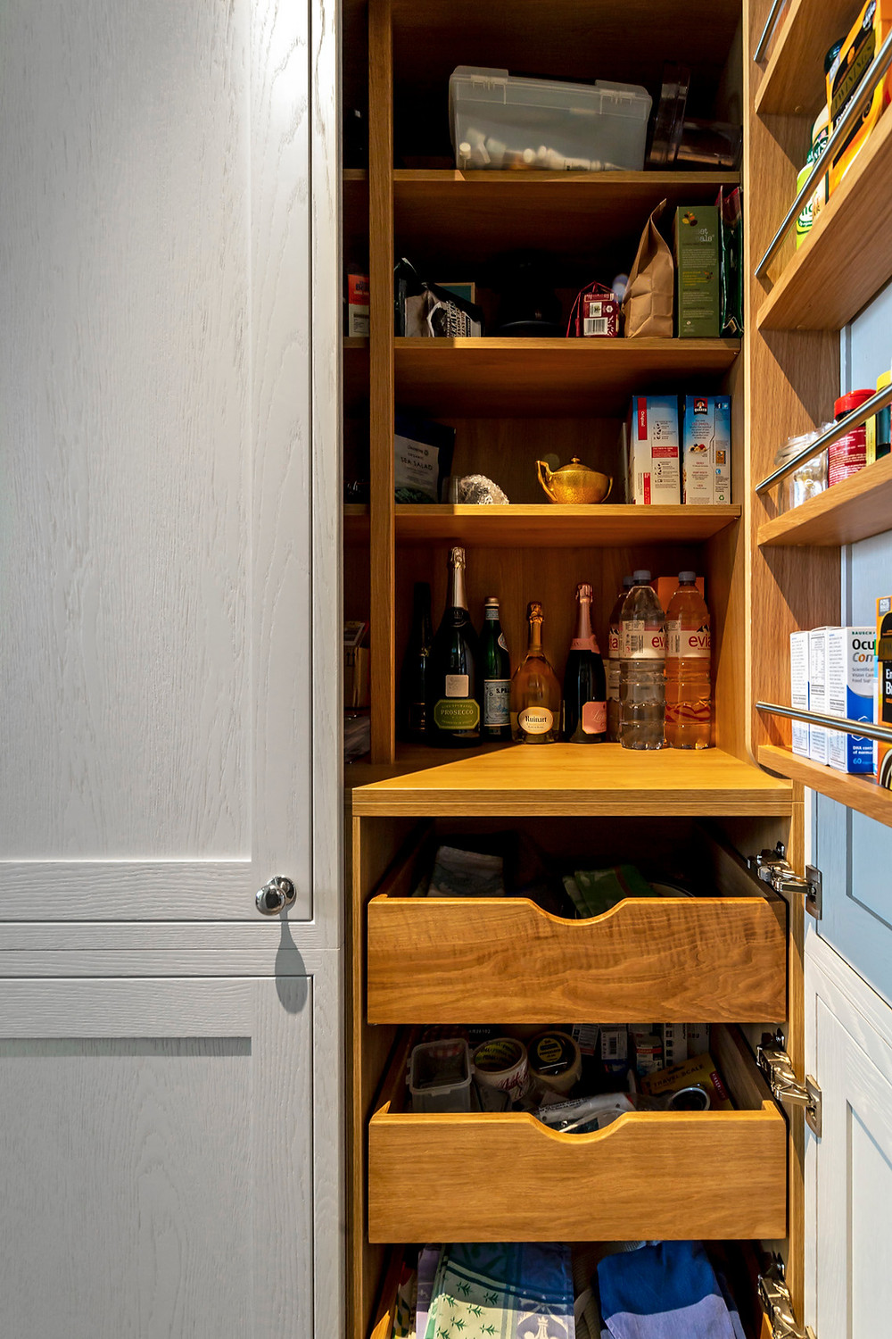 Pantry cupboard with wood internal shelving for dry goods and spices