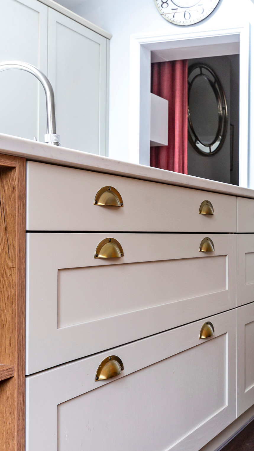 Kitchen drawers in island with gold cup handles