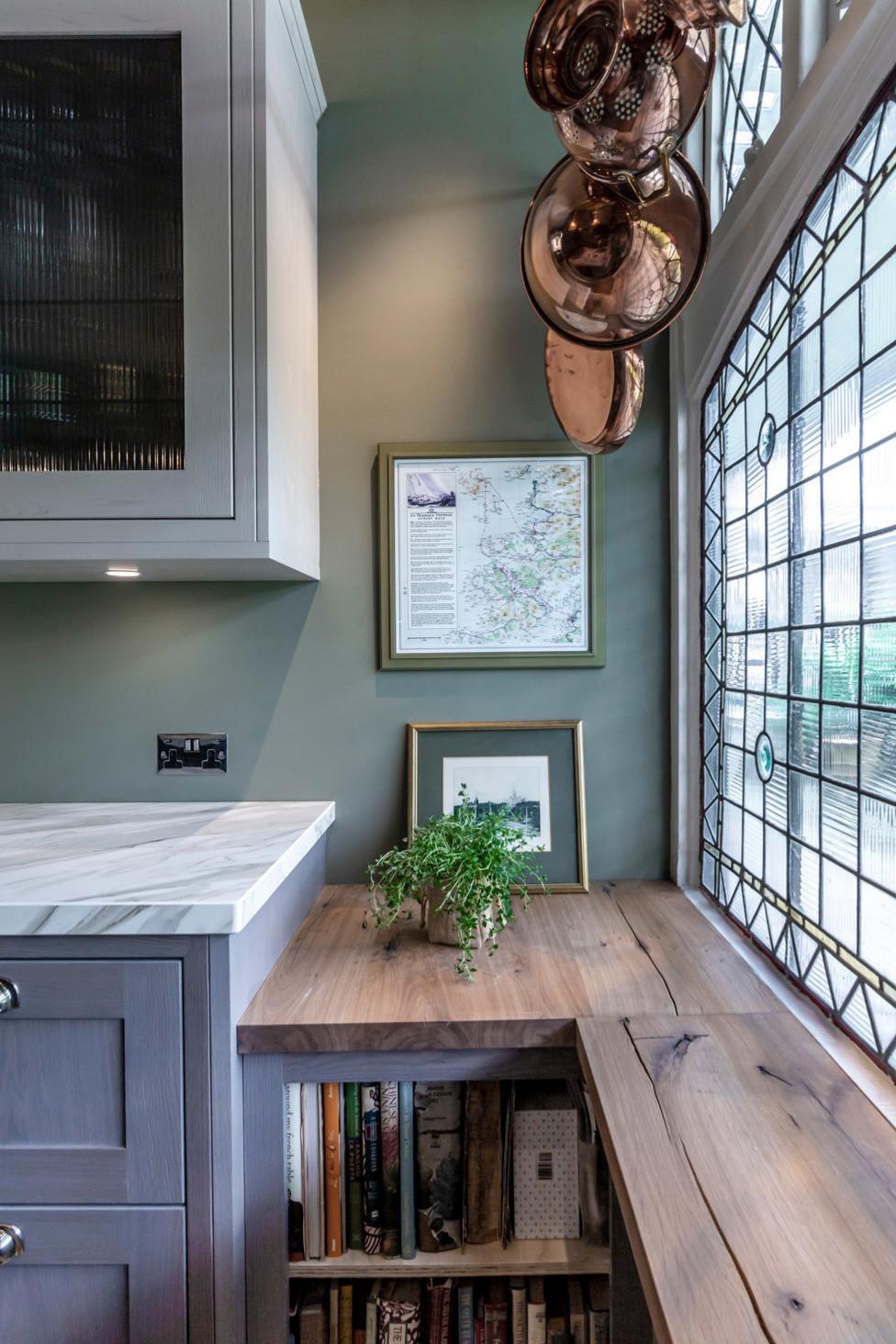 Rustic oak shelf under window in kitchen refurb with shelves for cookbooks