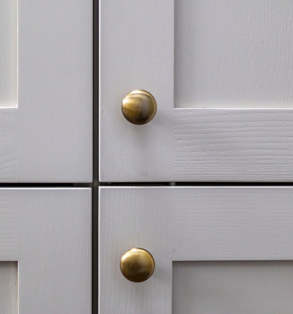 Gold kitchen knobs for integrated fridge and larder cupboard