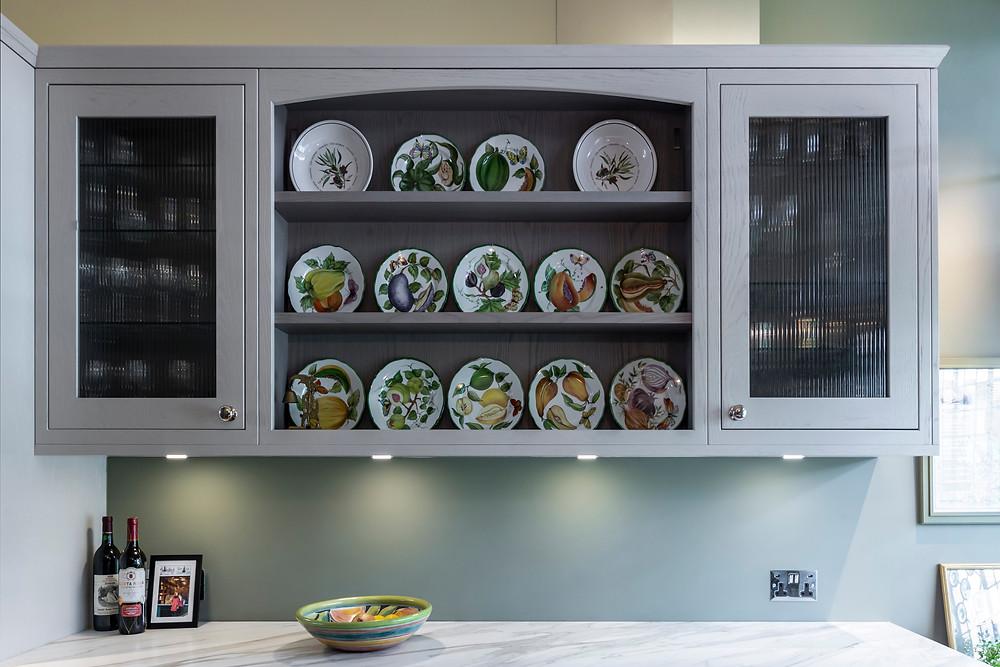 Open shelving display of hand painted plates from Provence in mews kitchen refurb